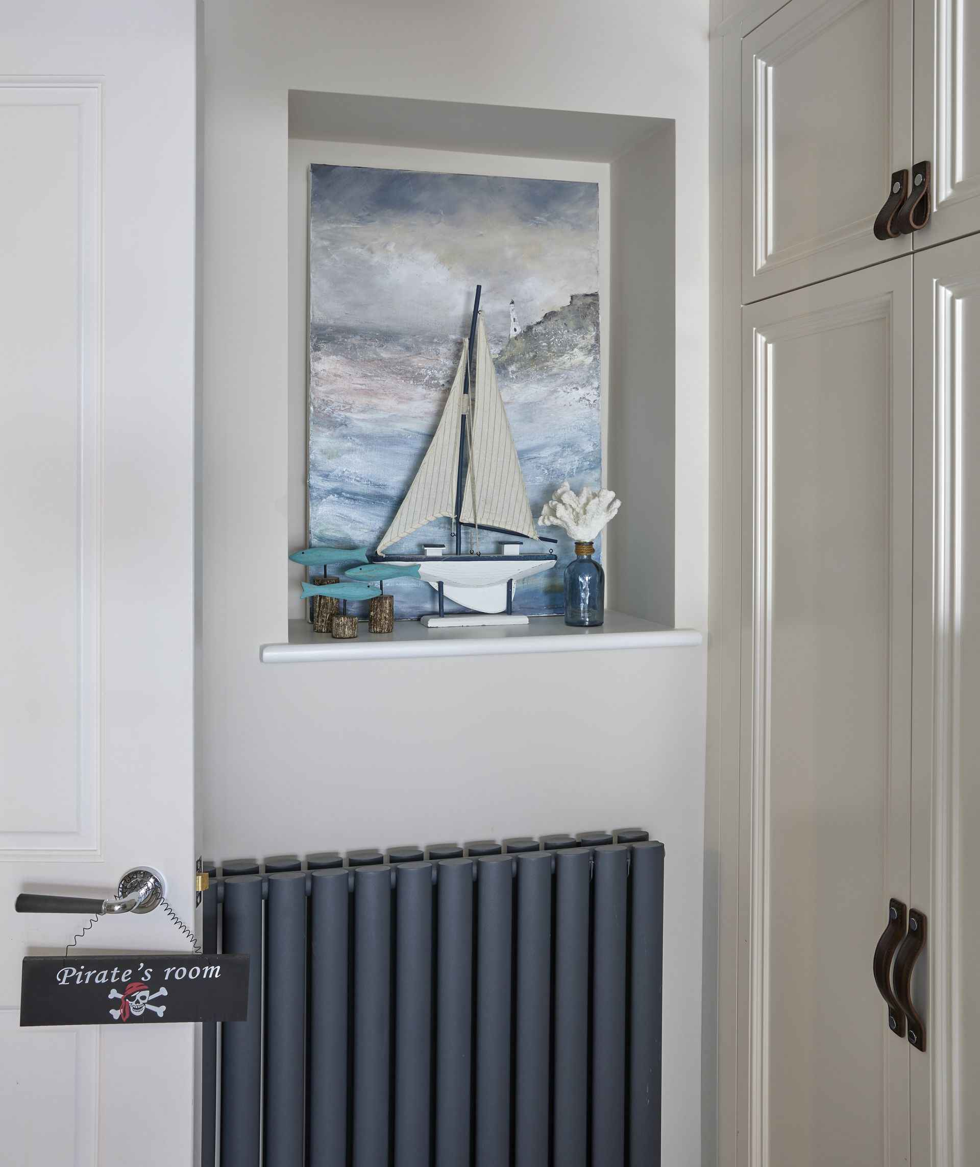 Sea and boat picture on the wall of the pirate room of mountain ash house