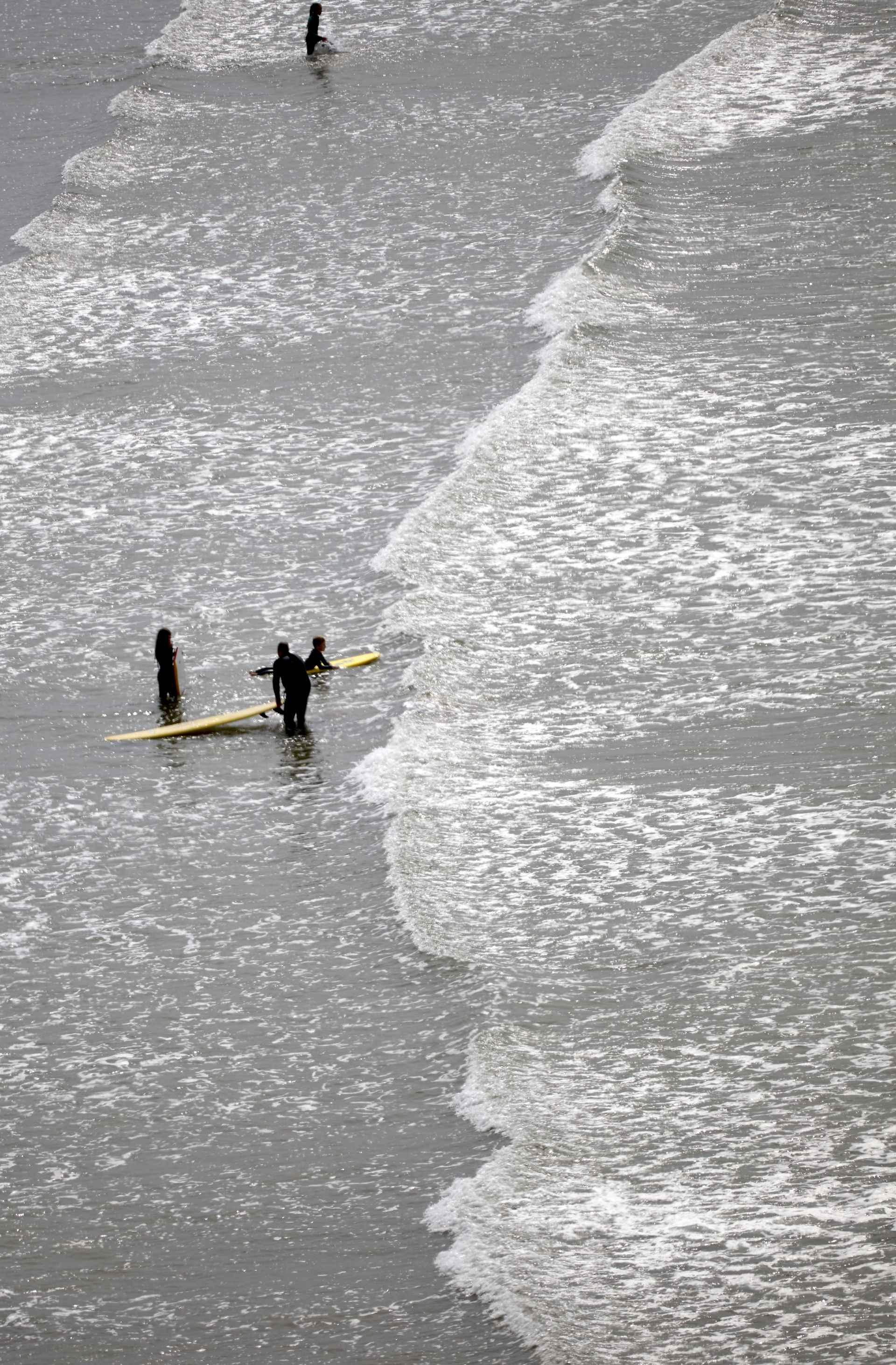 surfing in Combe bay Devon